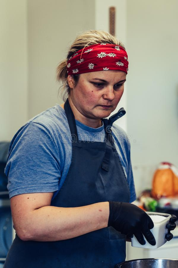 Female Chef Taking a Break from Meal Preparation - Frustrated, Worried, Concept of a Hard Working Person. Vintage Film Look stock photos