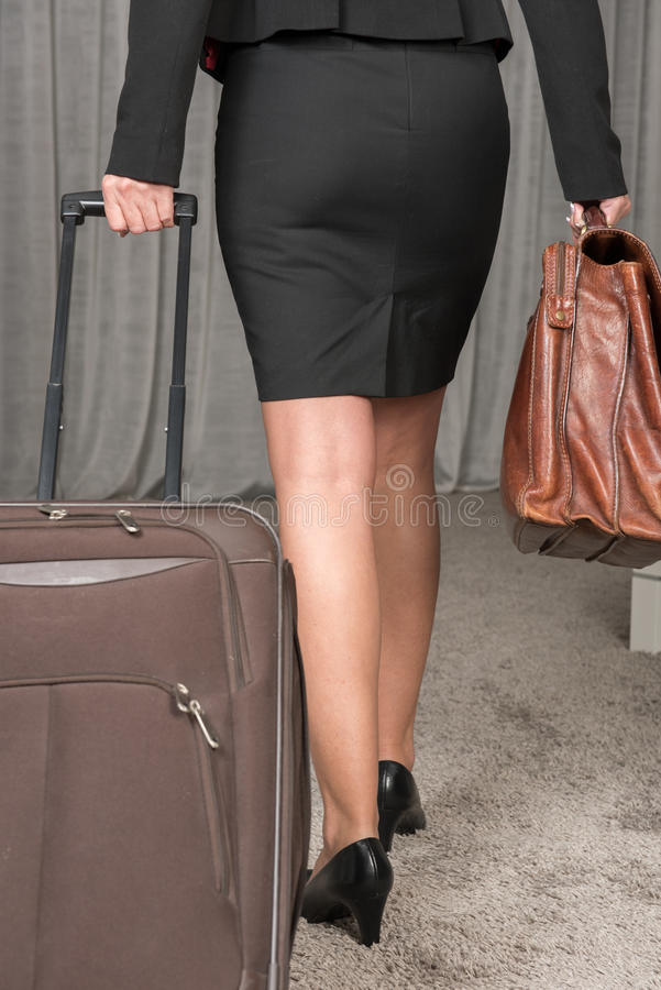 Female chef traveling with suitcase and brief case royalty free stock photography