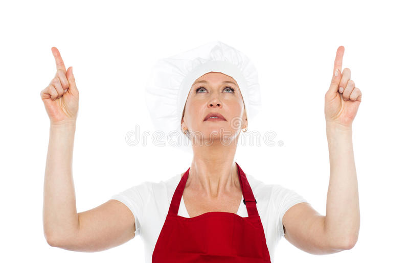 Download Female Chef In Uniform Pointing Upwards Stock Image - Image: 25997519