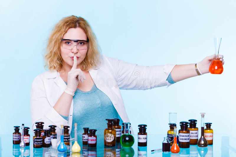 Female chemistry student with glassware test flask. stock photo