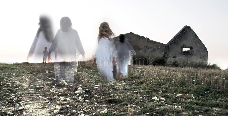 Female child ghost in abandoned house. Digitally created image of haunted house with girl reaching out at viewer stock image