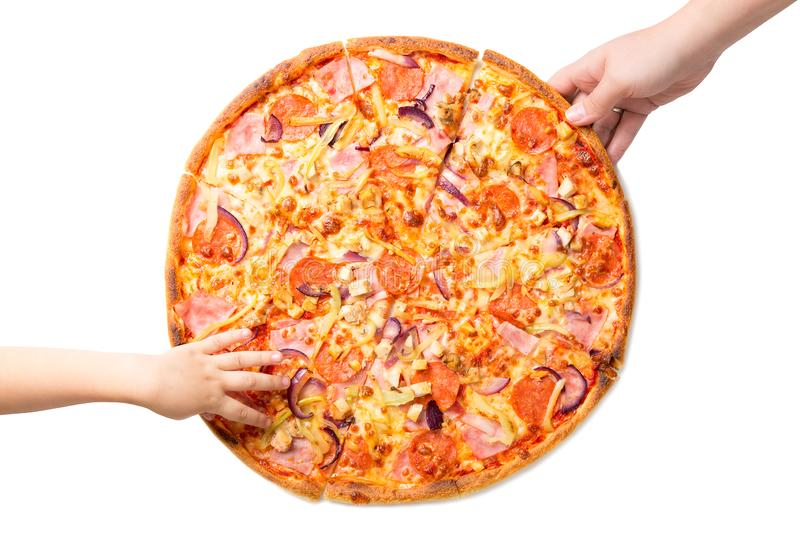 Female and childrens hands taking fresh and tasty pizza slices isolated on white background. stock photo