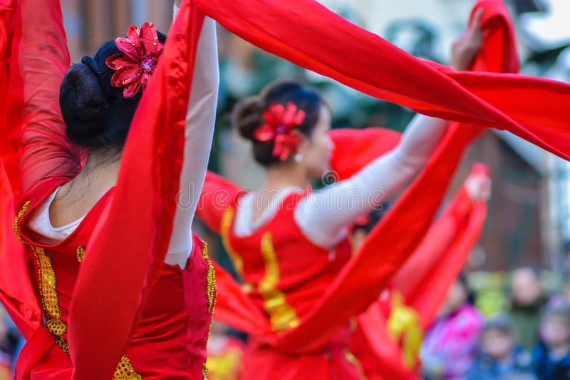 Female Chinese Dancers with Red ribbons. A group of beautiful female Chinese dancers performing with Red ribbons in celebration of the Chinese New Year (Year of royalty free stock photography