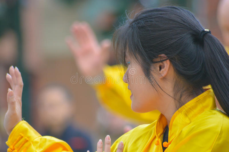 Female Chinese woman. A young Chinese woman performing a martial arts display at the Chinese New Year celebrations in Woking UK (2015 year of the sheep royalty free stock photography
