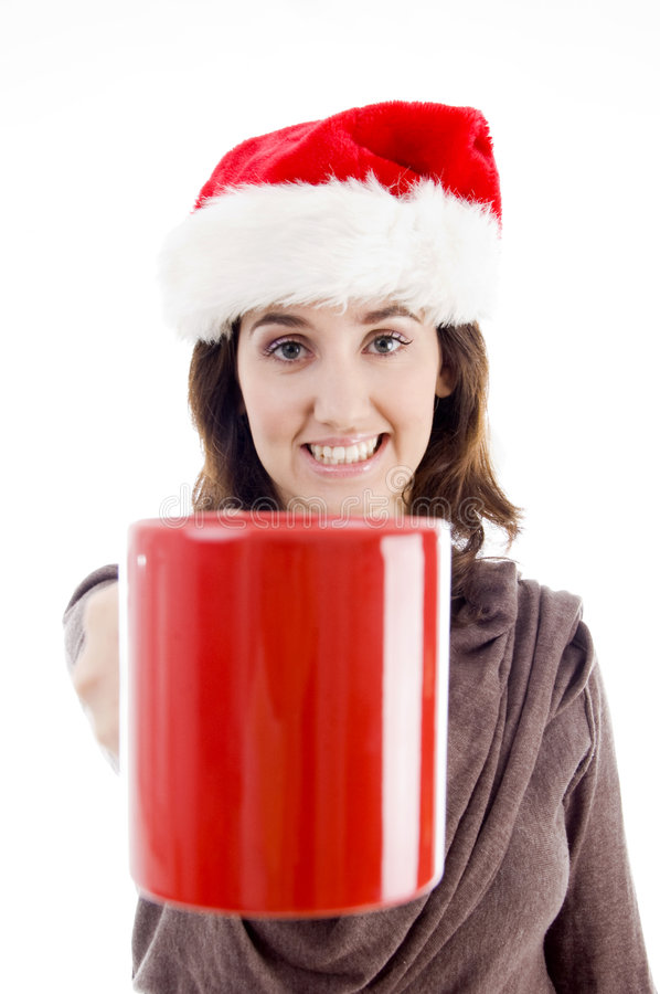 Female In Christmas Hat Showing Her Coffee Mug Stock Images