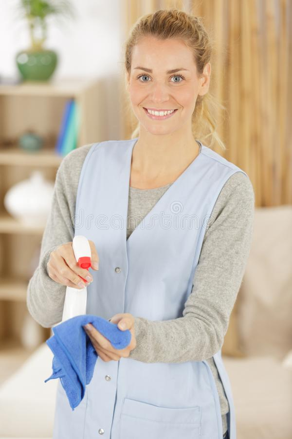 Female cleaner looking at camera stock photography