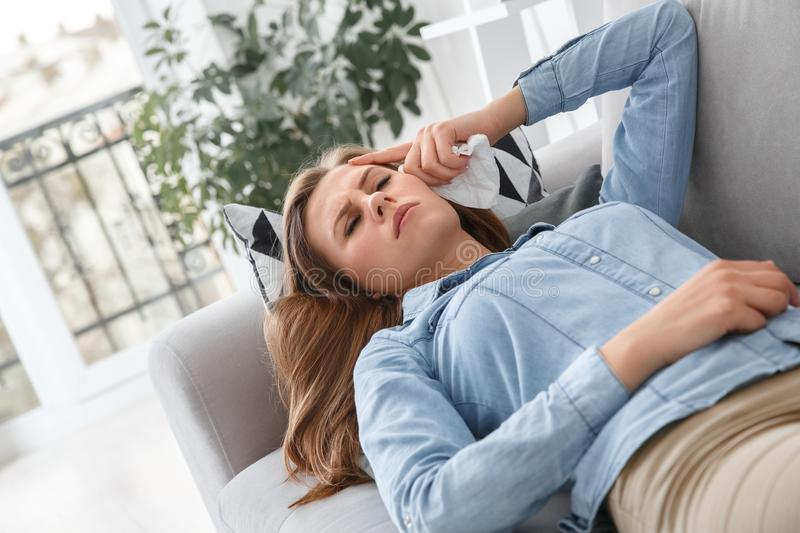 Female client lying on the sofa indoors psychology therapy session unahappy royalty free stock image