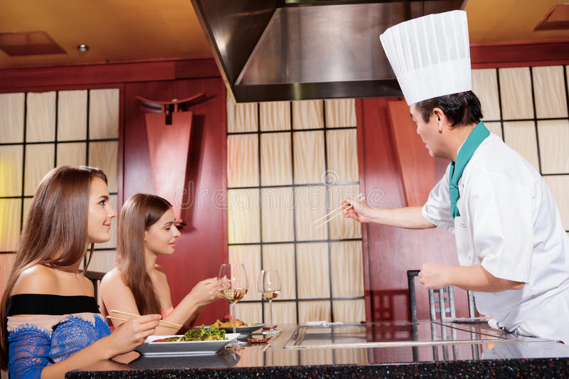 Female clients in Japanese restaurant stock photography