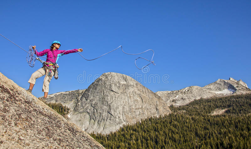 Female climber rappellling. royalty free stock photo
