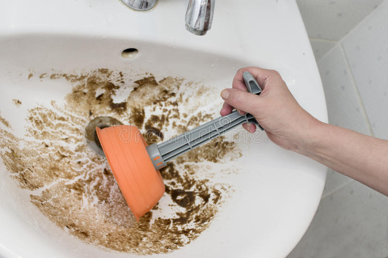 Female And Clogged Sink stock photos