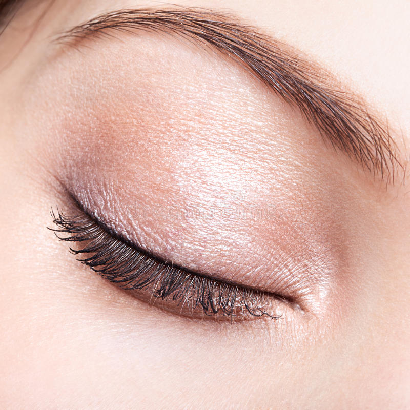 Female closed eye and brows with day makeup stock image