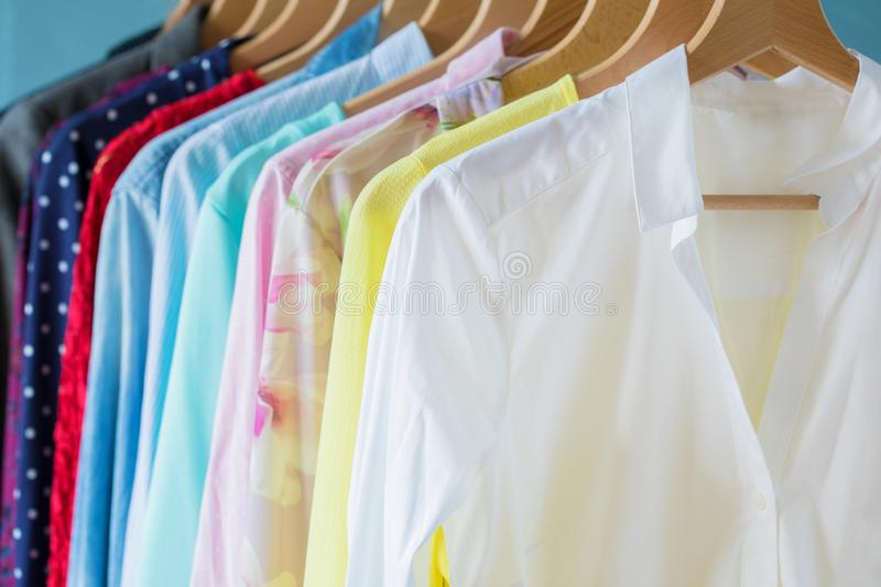 Female clothes hanging on rack stock image