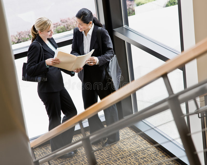 Female co-workers reviewing files together