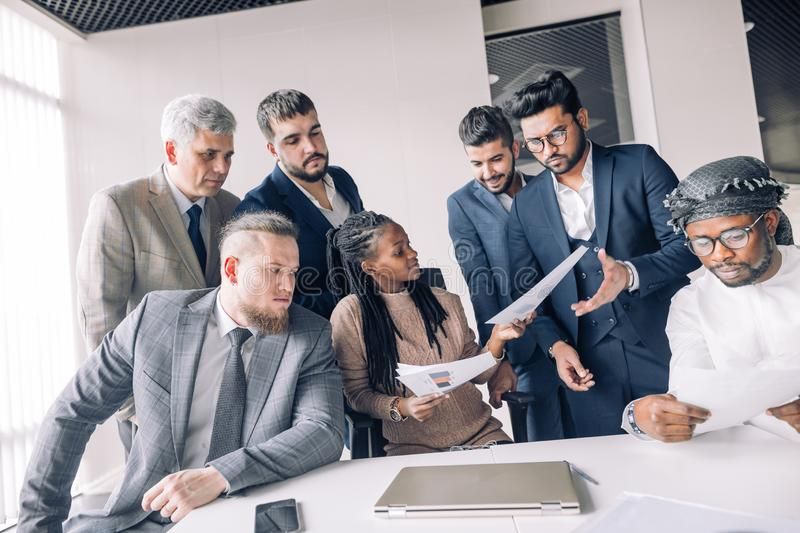 Female coach mentor talking with top managers in corporate training in office stock photo