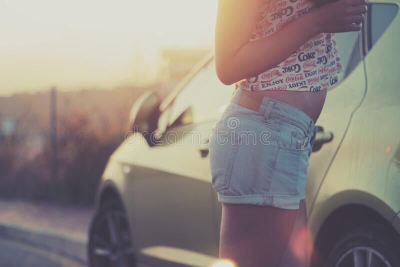 Female In Coke Shirt And Jean Shorts By Car Free Public Domain Cc0 Image