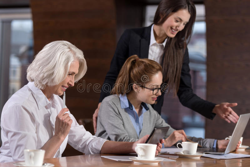 Female colleagues working on their project properly royalty free stock photos