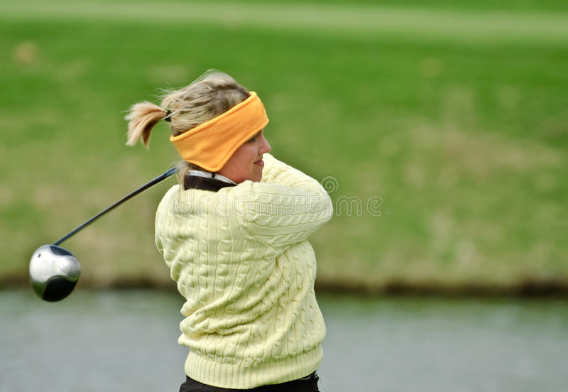 Female college golfer stock image