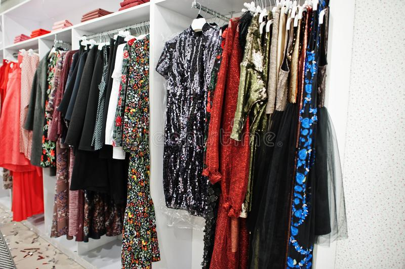 Female colorful clothing evening dresses set of on the racks in clothing store brand new modern boutique stock photo