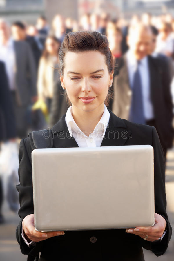 Female commuter in crowd royalty free stock images