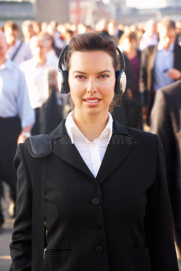 Download Female commuter in crowd stock image. Image of camera - 25429925