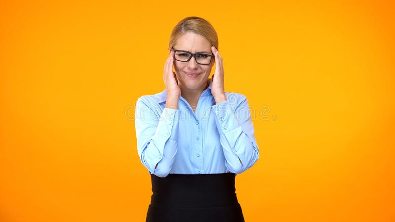 Female company worker feeling headache, suffering migraine, overload stress stock photography