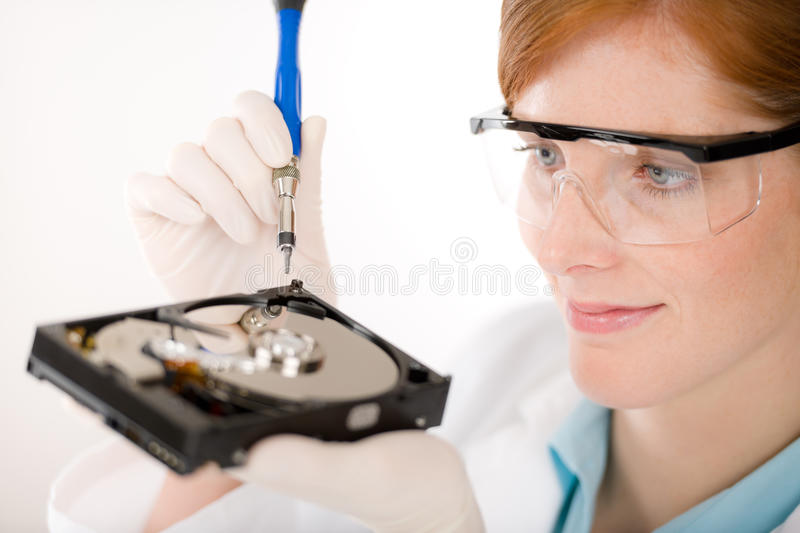 Female computer engineer - woman repair hard disc royalty free stock photo
