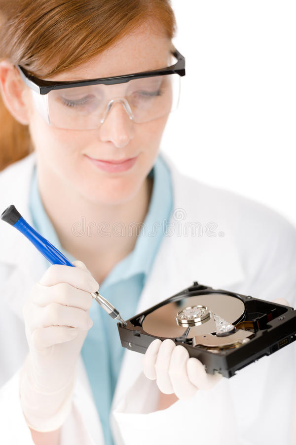 Female computer engineer - woman repair hard disc stock image