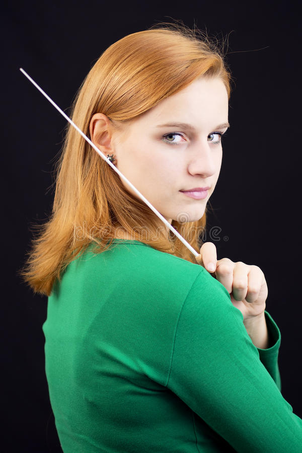 Female conductor. Portrait of female conductor in green royalty free stock photo