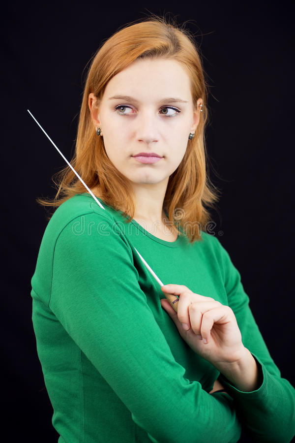 Female conductor. Portrait of female conductor in green royalty free stock images