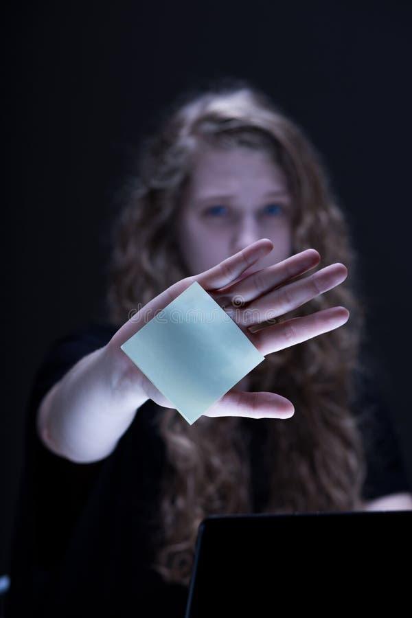 Female confronting online violence. Portrait of stressed female confrontig online violence stock photo