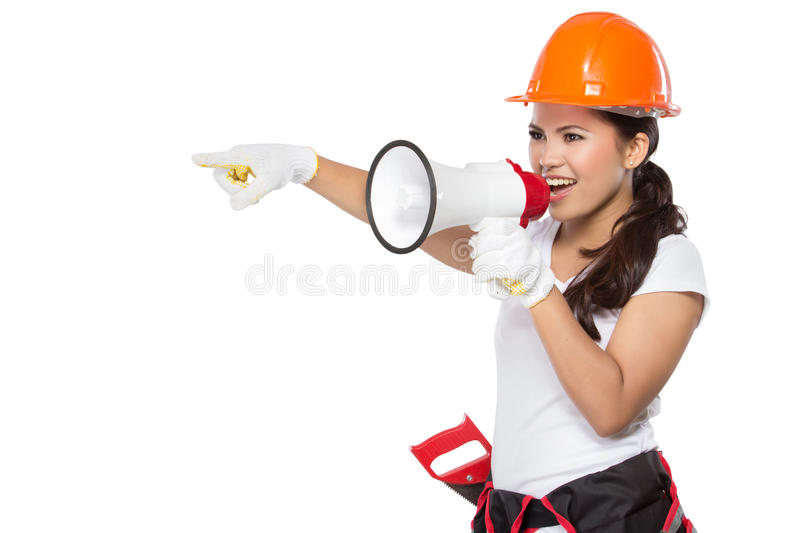 Female construction worker in action stock images