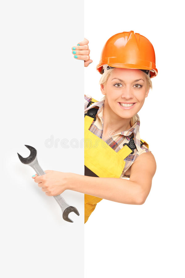 Download Female Construction Worker Behind Panel Stock Photo - Image: 26174654