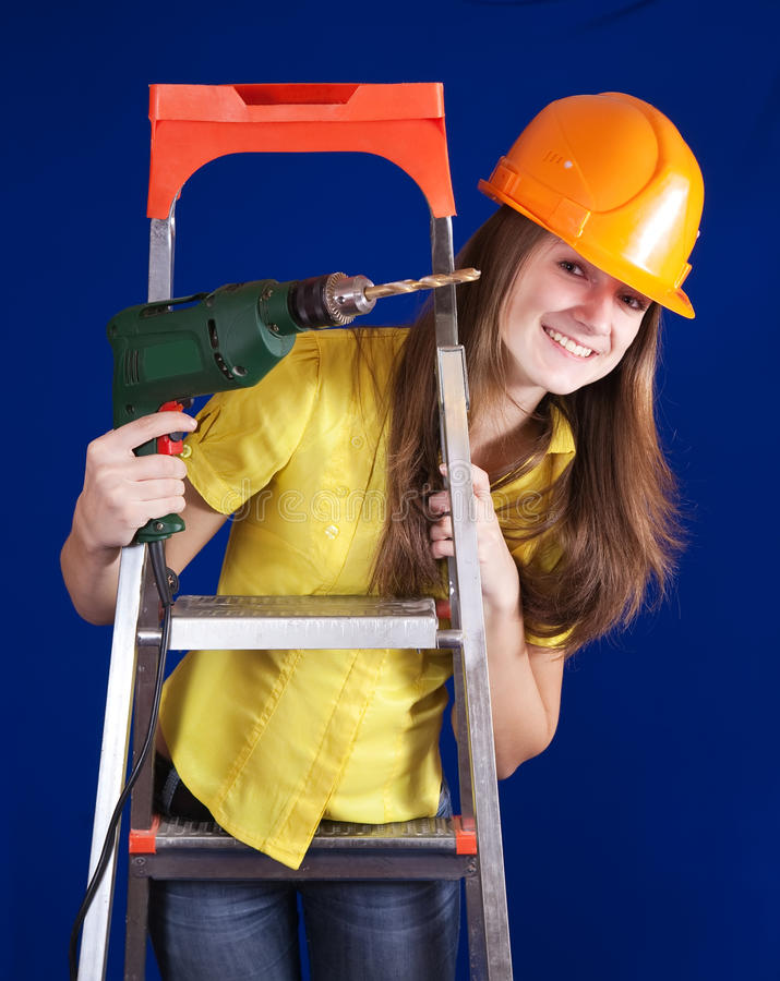 Download Female Construction Worker With Drill Stock Photo - Image of portrait, ladder: 16327360