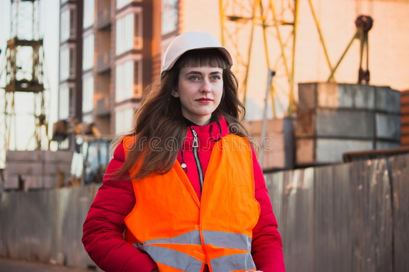 Female construction worker against gas separation plant royalty free stock photography