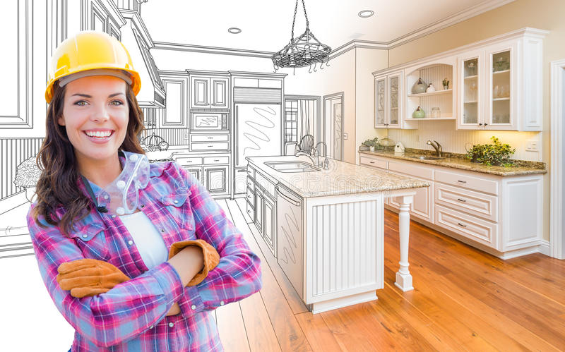 Female Construction Worker In Front of Custom Kitchen Drawing stock photography
