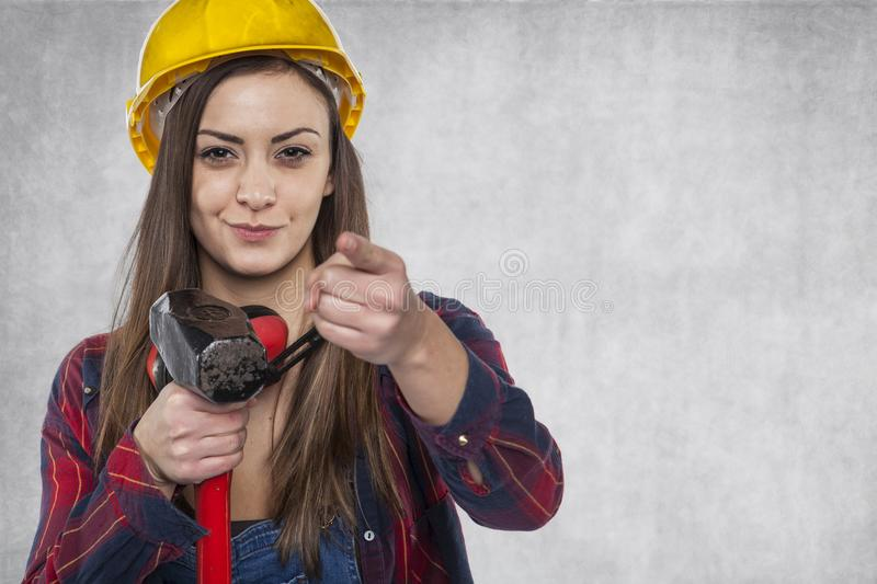 Female construction worker pointing at you royalty free stock photo