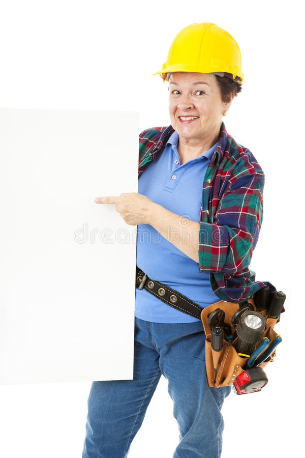 Female Construction Worker - Sign royalty free stock photography
