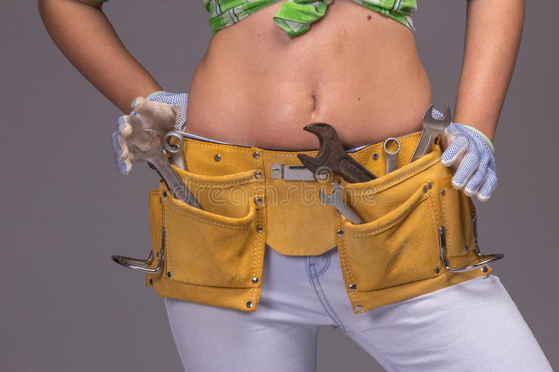 Female Construction Worker With Tool belt. Close up view royalty free stock images