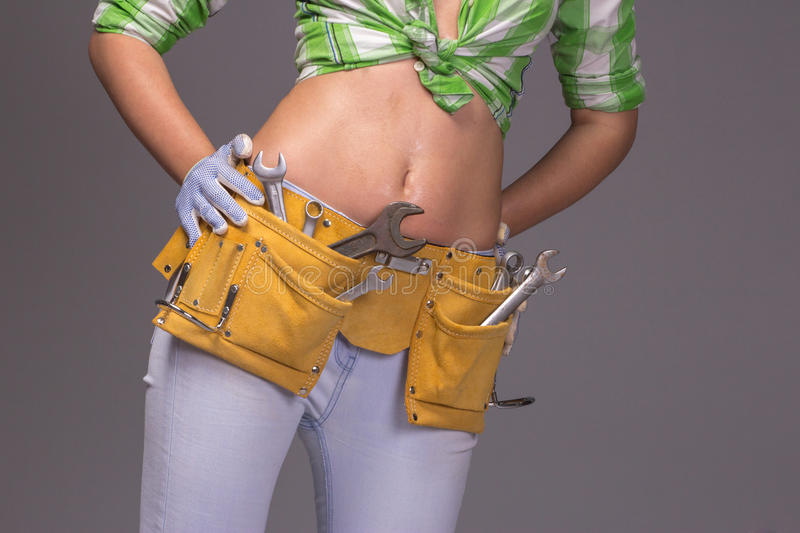 Female Construction Worker With Tool belt. Close up view stock images
