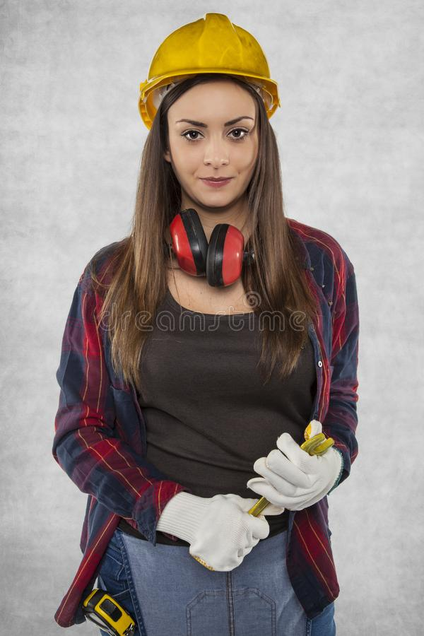 Female construction worker, working as plumber royalty free stock photos