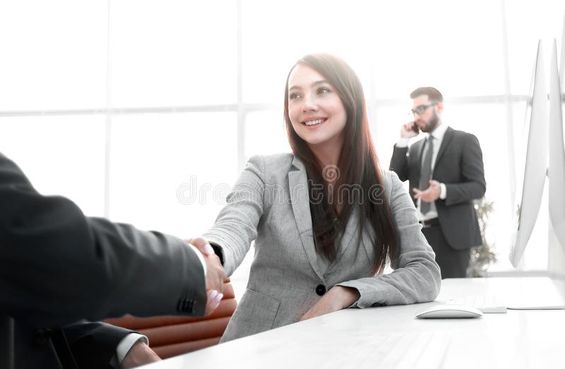 Female consultant greeting the customer . royalty free stock image