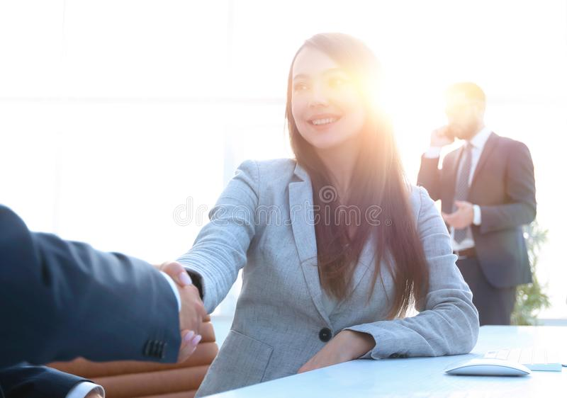Female consultant greeting the customer . Photo with copy space stock photo