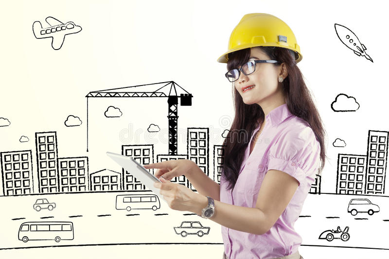 Female contractor using digital tablet stock images