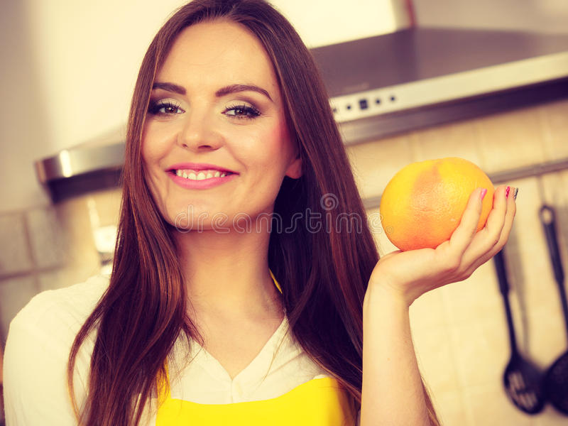 Female cook holding fruit. stock photography