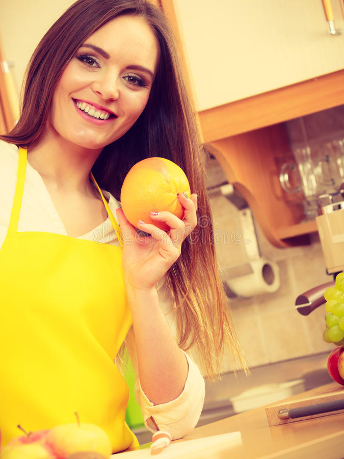 Female cook holding fruit. royalty free stock image