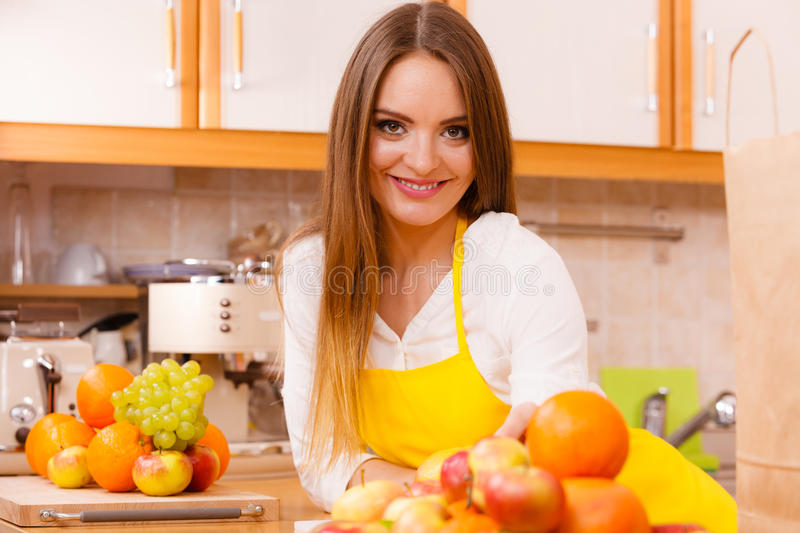 Female cook working in kitchen. royalty free stock image