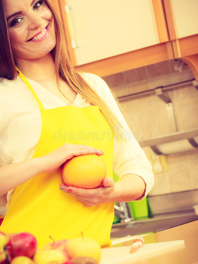 Female cook working in kitchen. stock photo