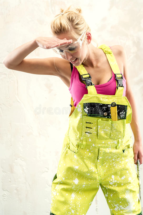 Female in coverall indoors stock photos