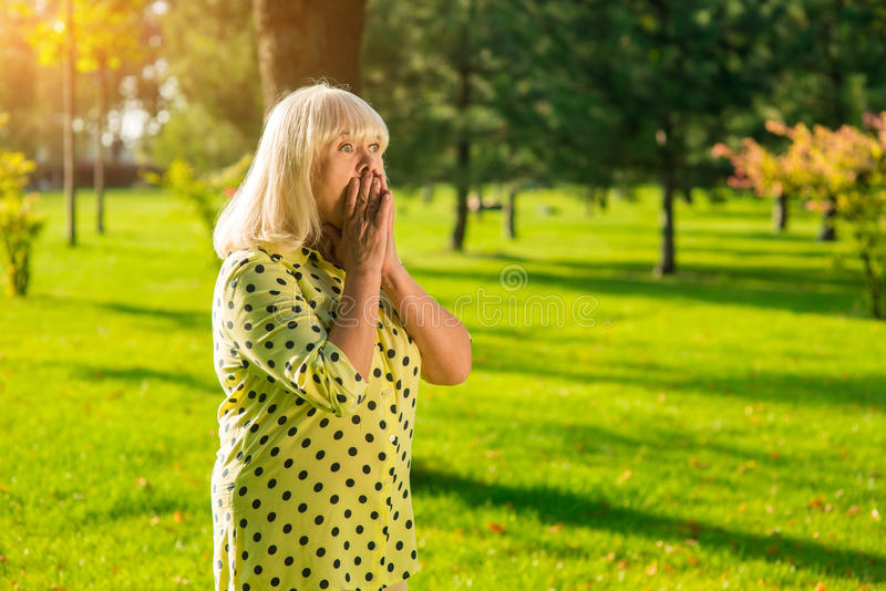 Female covers mouth with hands. royalty free stock images