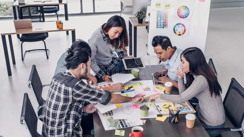 Female Creative director team leader brainstorm branding project with designer team at meeting table.discussion idea in creative. Office royalty free stock photography